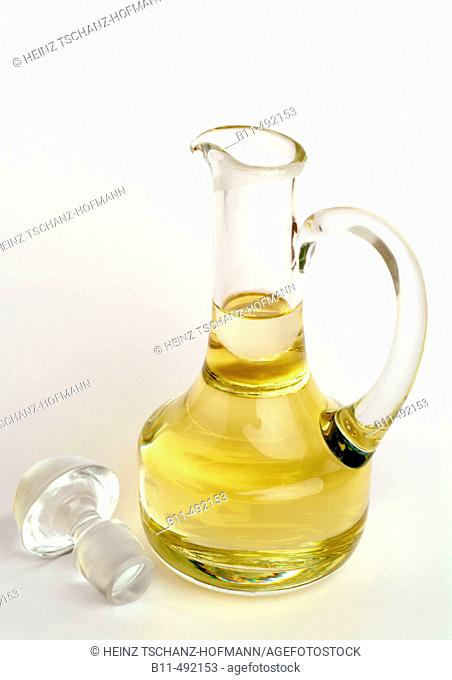 Edible oil in a glass carafe