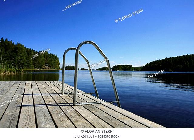 Private jetty in a bay under blue sky, Saimaa Lake District, Finland, Europe