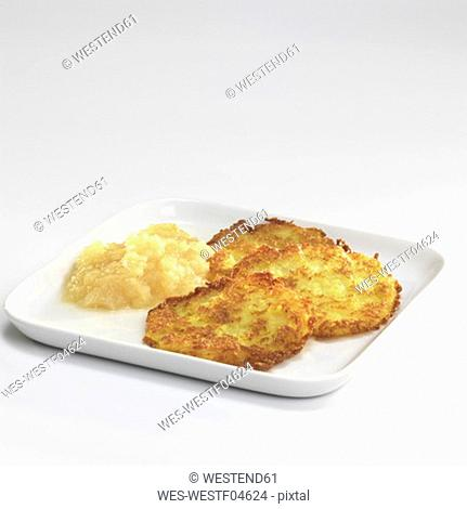 Potato fritters with apple sauce on plate