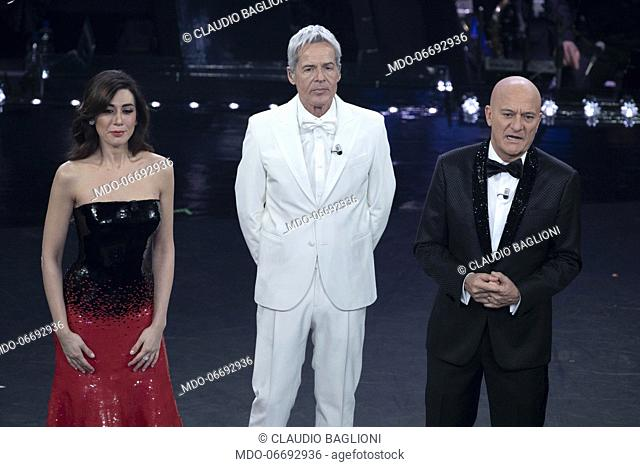 Italian comedians and hosts Virginia Raffaele and Claudio Bisio and Italian singer and host Claudio Baglioni during the fifth and last evening of the 69th...