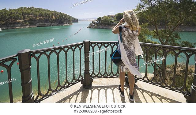 Malaga Province, Andalusia, southern Spain. Conde de Guadalhorce reservoir. Embalse del Conde de Guadalhorce. Woman enjoying view at lookout point