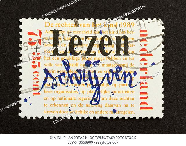 HOLLAND - CIRCA 1980: Stamp printed in the Netherlands shows a writing by a child, circa 1980