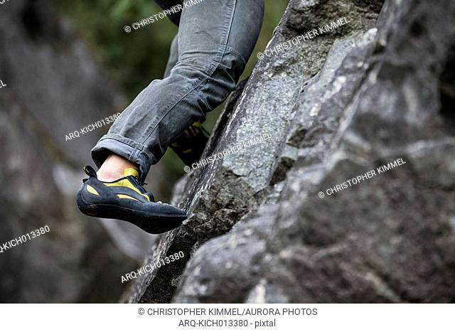 Low section of climber bouldering near Elbow Lake in Fraser Valley, Harrison Mills, British Columbia, Canada