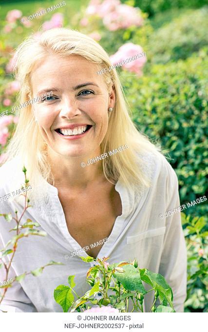 Portrait of mid adult woman in garden