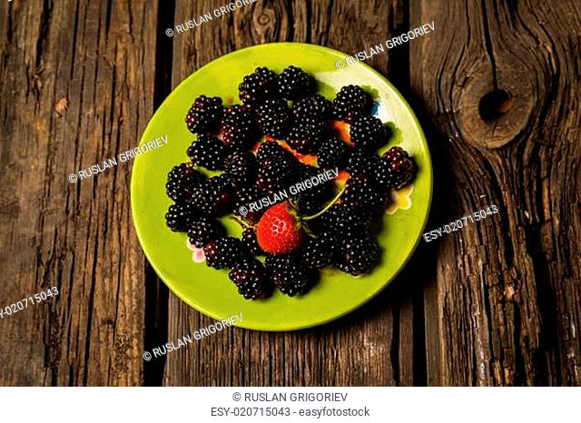 Collection of wild berries and strawberry