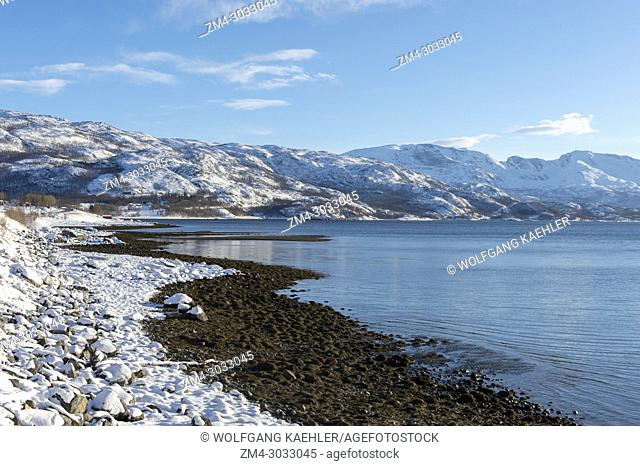 The snowy coastline in the winter at Bjerkvik, near Narvik in northern Norway