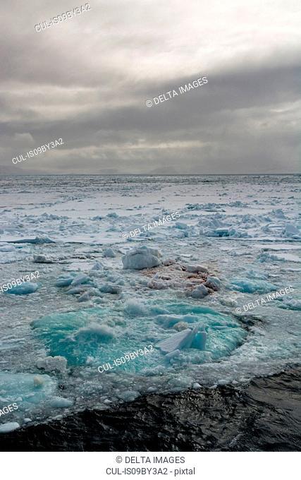 Shorefast ice and stormy sky, Wahlenberg Fjord, Nordaustlandet, Svalbard, Norway