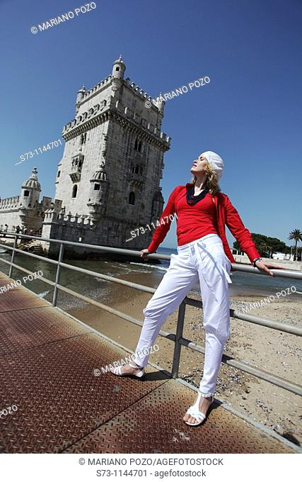 Woman poses front Belem Tower, Lisbon, Portugal