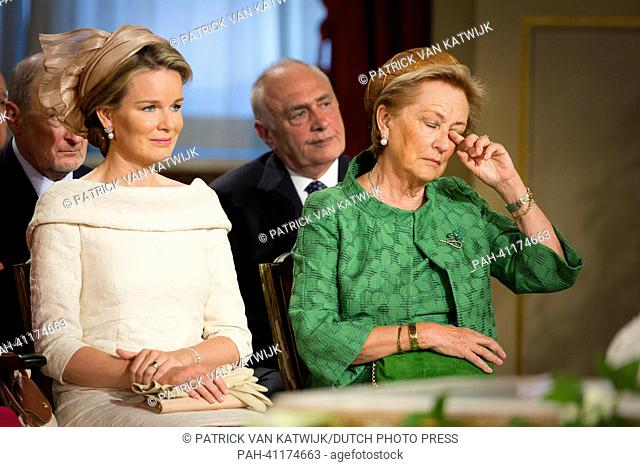 Queen Paola of Belgium (R) and Princess Mathilde of Belgium (L) react during the Abdication ceremony of King Albert II of Belgium (not pictured) held at the...