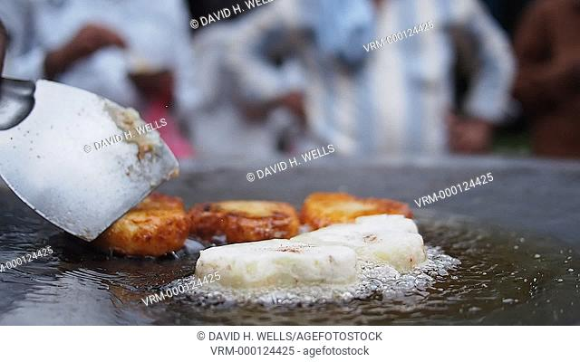 Potato being fried on griddle at Haridwar, Uttarakhand, India