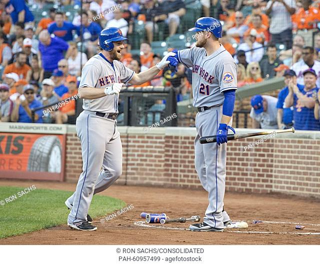 New York Mets second baseman Daniel Murphy (28) is congratulated by first baseman Lucas Duda (21) after connecting for a first inning home run against the...