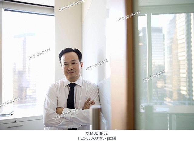 Portrait confident businessman in highrise office
