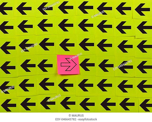 Arrows. Opposite concept. Background of green sticky notes