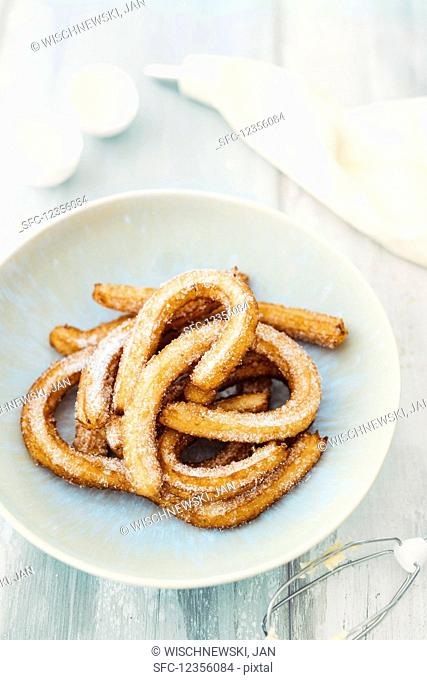 Churros (deep fried pastry biscuits, Spain)