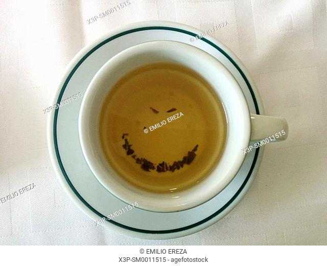 Smiling face in a cup of tea