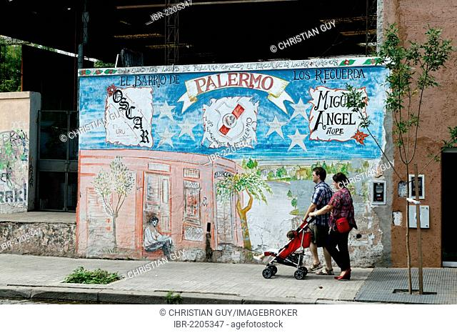 Family passing painted house, Palermo Viejo district, Buenos Aires, Argentina, South America