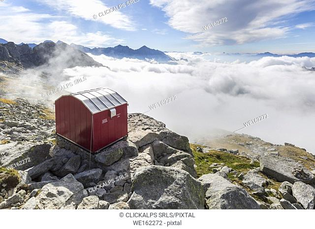 Lombardy, Italy, the Molteni biwak in Ferro valley clouds above