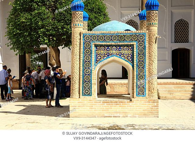 Bukhara, Uzbekistan - August 28, 2016: Tourists at Memorial complex of Khoja Bakhouddin Naqshbandi, a most important pilgrimage place for Islam