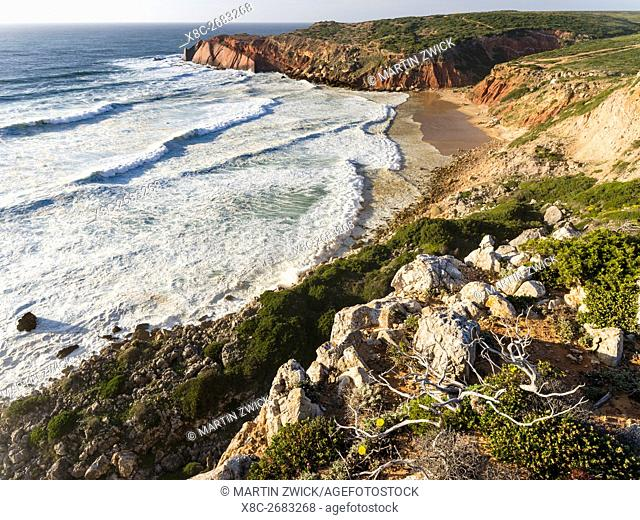 Beach and cliffs at Praia do Telheiro at the Costa Vicentina. The coast of the Algarve during spring. Europe, Southern Europe, Portugal, March