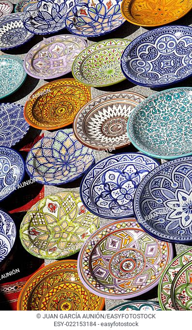 Traditional arabic handcrafted, colorful decorated plates of Morocco