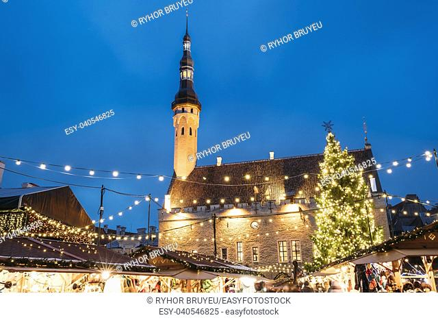 Traditional Christmas Market On Town Hall Square - Raekoja Plats In Tallinn, Estonia. Christmas Tree And Trading Houses With Sale Of Christmas Gifts