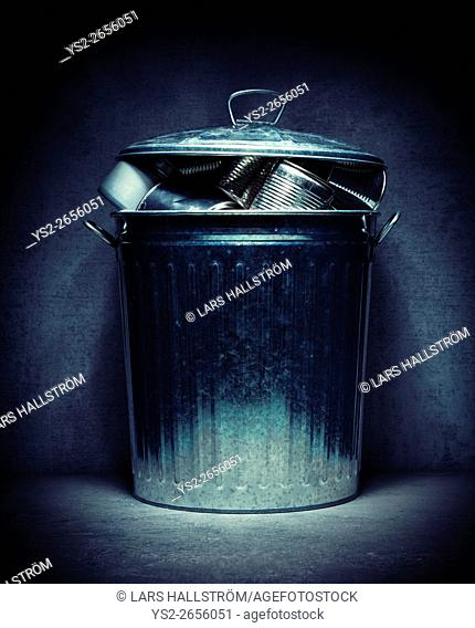 Metal recycling in trash can. Environmental still life. Concept of garbage handling, eco awareness and green lifestyle