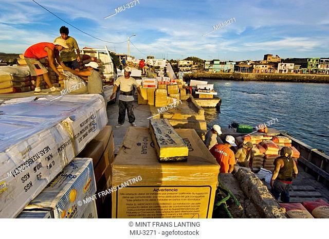 Men unloading supplies from mainland, San Cristobal Island, Galapagos Islands