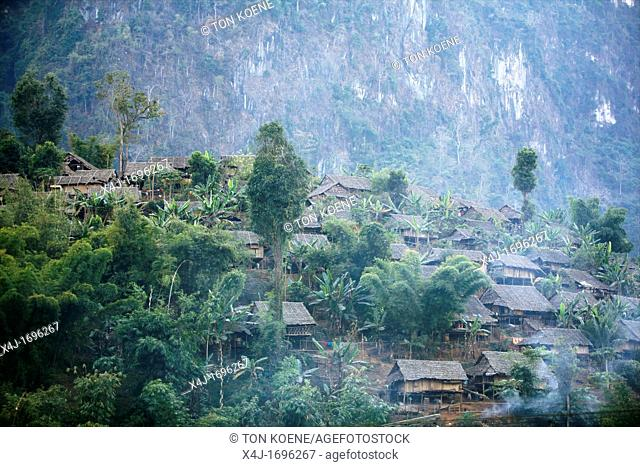 Family huts on a hillside in Mae Sot Around 130,000 Burmese refugees have settled in Thailand due to opression in their homeland of Myanmar Burma Approximately...