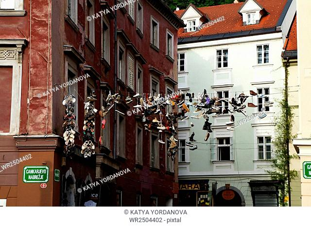 Shoes hanging on a lines around Preseren Square in Ljubljana, Slovenia