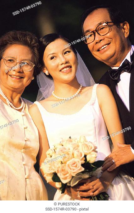 Close-up of a bride smiling with her parents