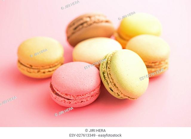 Tasty sweet macarons. Macaroons on pink background