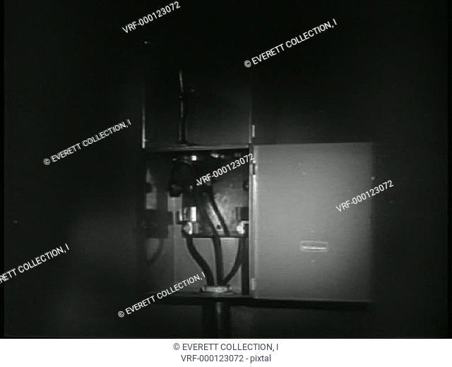 Close-up flashlight on electrical box