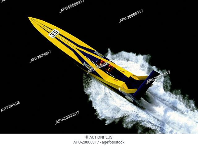 Yellow Powerboat drives through still water in race
