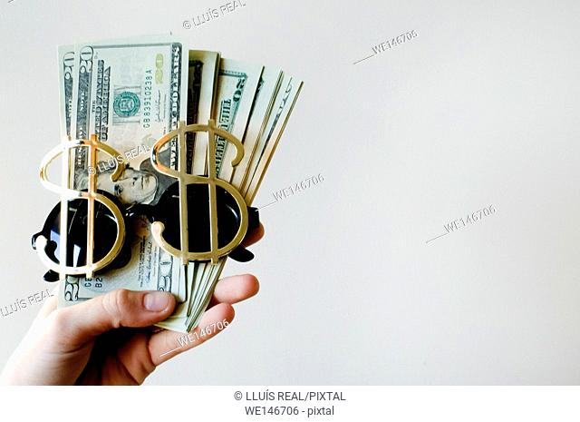 group of twenty dollar bills with a pair of sunglasses with the dollar symbol