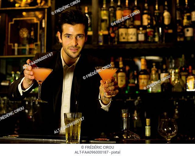 Bartender serving cocktails