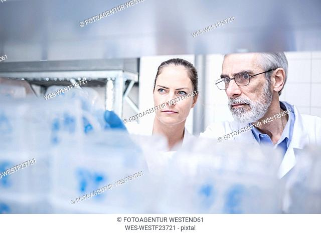 Portrait of two scientists in lab
