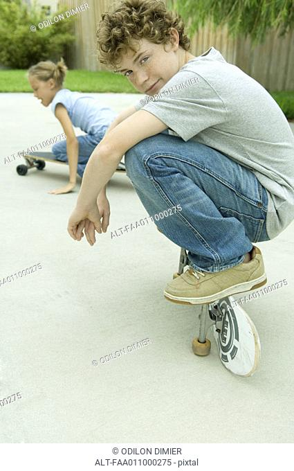 Kids playing on skateboards