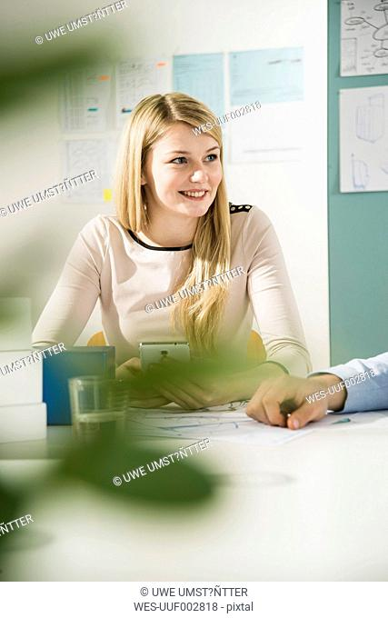 Young woman in a business meeting