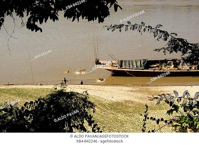 Laos, North, Muang Khua, Nam Ou river, boat and people bathing