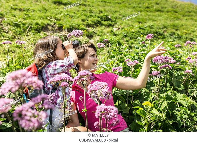 Mother and daughter with binoculars, Tyrol, Austria