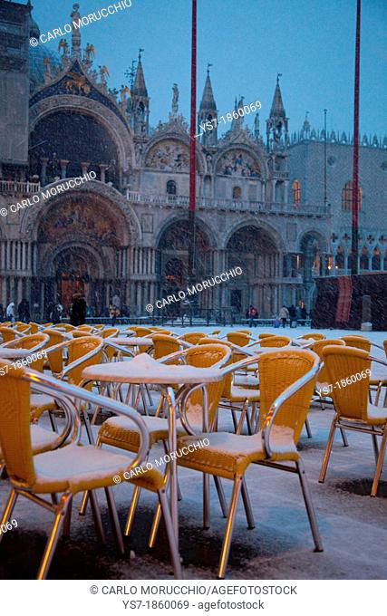 The Quadri's bar chairs covered with snow, St  Mark's square, Venice, Italy, Europe