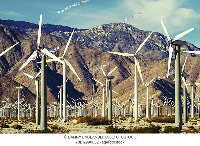 Wind turbines and rugged mountains in Palm Springs, California