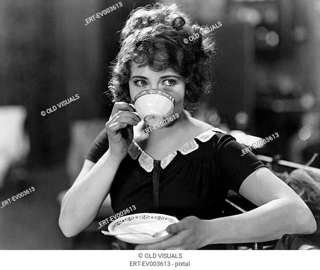 Portrait of woman drinking from teacup All persons depicted are not longer living and no estate exists Supplier warranties that there will be no model release...