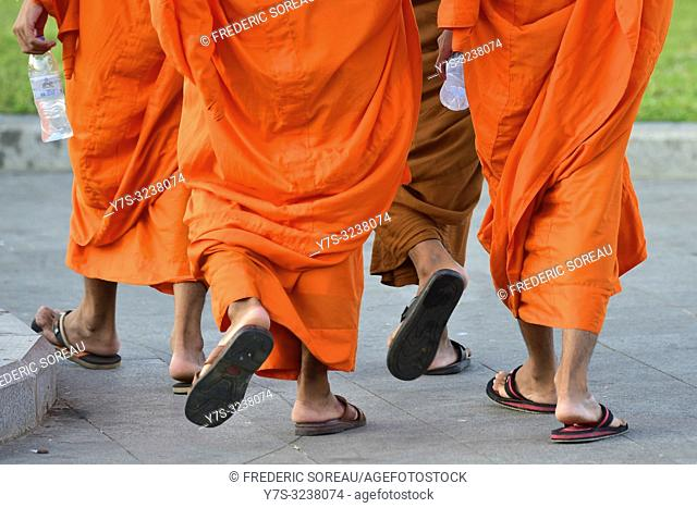Buddhist monks in the park along the Preah Thineang Chan Chhaya in Phnom Penh,Cambodia,South east Asia