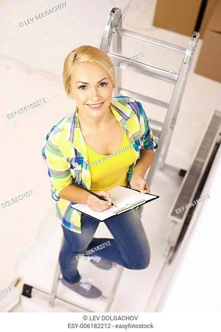 repair, building and home concept - smiling woman with clipboard
