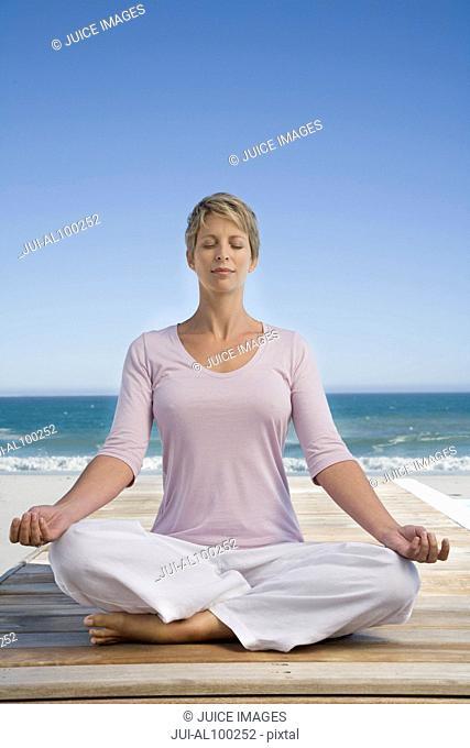 Woman doing yoga on patio