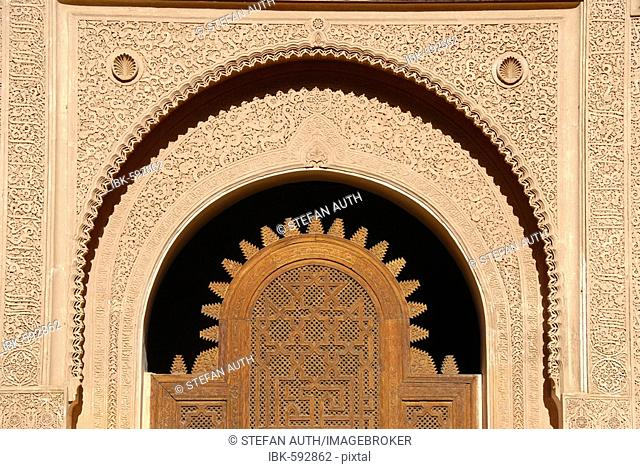 Oriental portal made of cedar wood with fine stucco richly decorated Medersa Ali Ben Youssef medina Marrakech Morocco