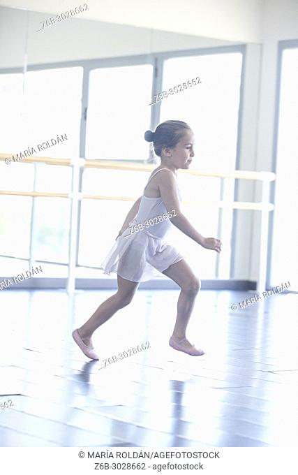 little girl dressed in ballet outfit running