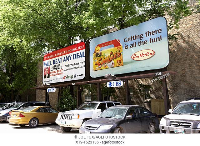 advertising boards for tim hortons and a local car dealer in a car park in winnipeg manitoba canada