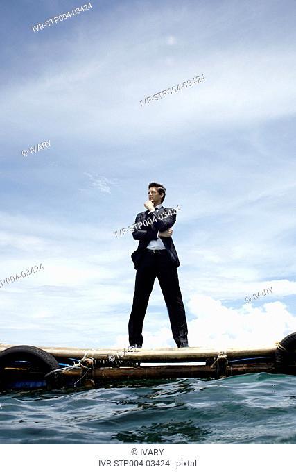 A businessman posing on a dock